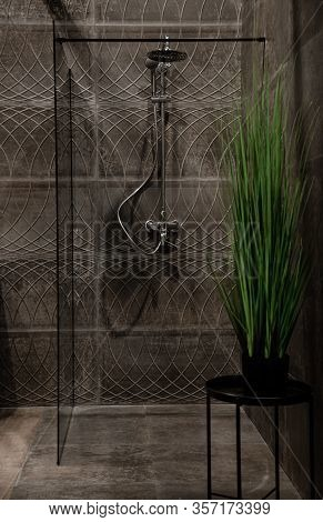 The Interior Of A Modern Bathroom With A Shower, Against The Background Of A Wall With Beautiful Til