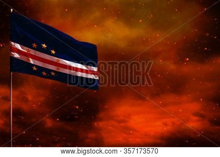 Fluttering Cabo Verde Flag Mockup With Blank Space For Your Data On Crimson Red Sky With Smoke Pilla