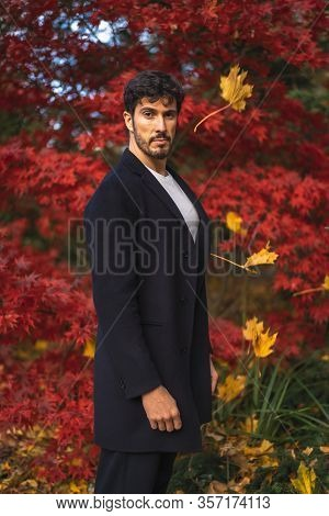 A Young Entrepreneurial Businessman In A Session With Autumn Colors In The Background