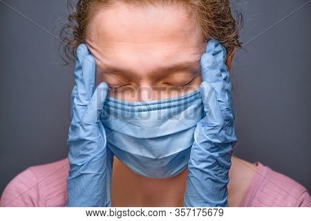 Coronavirus Covid-19. Pandemic Background. Face Of Tired Woman In Medical Mask And Gloves. Despaired