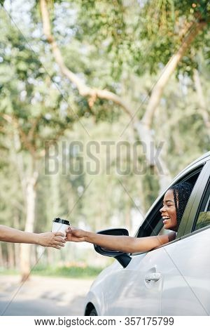 Excited Happy Young Black Woman Buying Take Out Coffee In Drive Through Cafe
