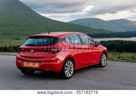 Scotland Highlands - August 2, 2019: Red Vauxhall Astra Hatchback Parked In Scottish Highlands With