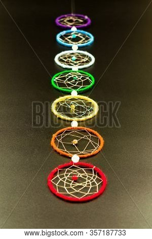 Chakras On A Black Background. Decoration On The Wall Of Seven Chakras.