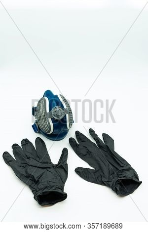 Vertical View Of Black Nitrite Gloves And Coronavirus Mask Isolated On A White Background Pandemic C