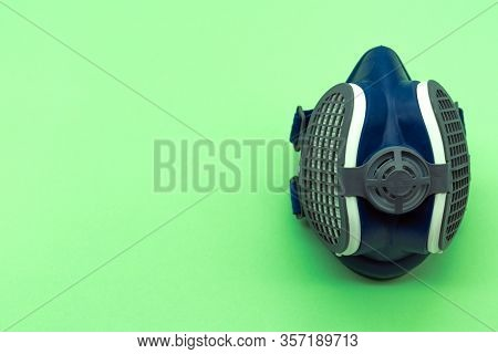 Top View Of Isolated Coronavirus Mask On A Green Background, Located On The Right Of The Image With