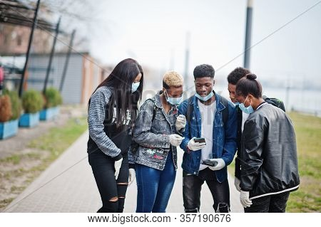 Group Of African Teenagers Friends At Park Wearing Medical Masks Protect From Infections And Disease