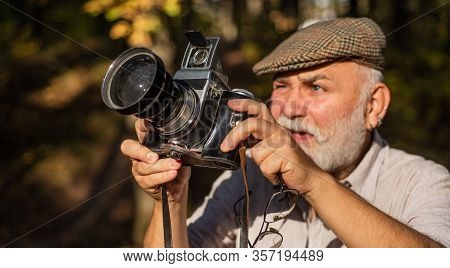 Professional Nature Photographer. Bearded Pensioner Take Travel Photo. Vintage Retro Photo Camera. M