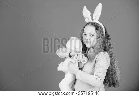 Cute And Adorable. Bunny Girl With Cute Toy On Blue Background. Child Smiling Play Bunny Toy. Happy