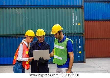 Foreman And Worker Staff Working Checking Shipping Order On Laptop At Container Yard. Business Logis