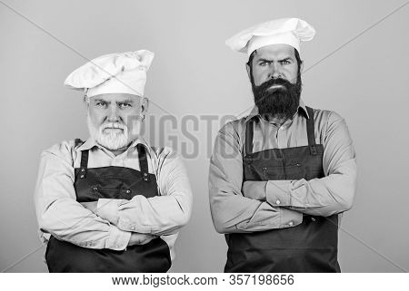 Family Dinner. Father And Son Cooking Together. Commercial Kitchen At Restaurant. Professional Chefs