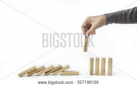 Businesswoman Hand Stopping Dominoes From Falling On Desk Isolate On White Background. Effect From C