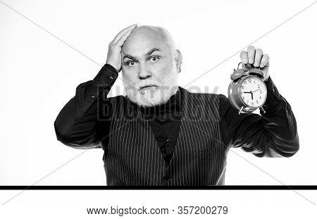 Time And Age Concept. Bearded Man Clock Ticking. Aged Man Holding Alarm Clock. Senior Man White Bear