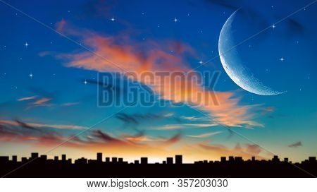 New Moon . The Sky At Night With Stars. Sunset Above The City