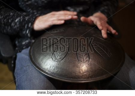 Playing The Drum Of Metal. Meditative Music. Hang Is A Sheet Music Game On Metal Plates. Music Lesso