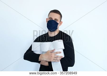 Man Storing Tissue Toilet Paper During Covid 19, Concept Quarantine. People Are Stocking Up Toilet P