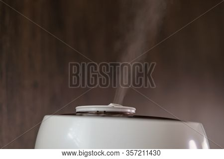 Aroma Oil Vapour From Humidifier Or Diffuser Moisture In The House.