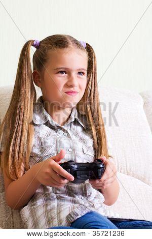 Girl playing video game.