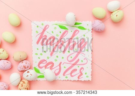 Happy Easter Concept. Inscription Happy Easter Letters Candy Chocolate Eggs And Jellybean Sweets Iso