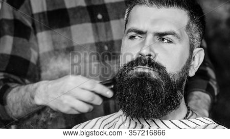 Confident Man Visiting Hairstylist. Barber Shop. Bearded Hipster Getting New Hairstyle. Vintage Barb