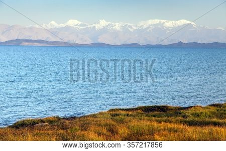Karakul Lake And Pamir Range In Tajikistan. Landscape Around Pamir Highway M41 International Road
