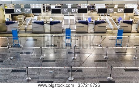 Empty International Airport Building, Lack Of Passengers During The Global Crisis And Diseases. Empt