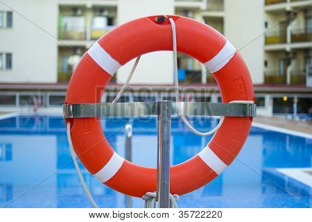 Lifebuoy near the pool placed on a stand
