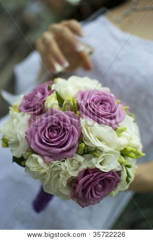 Bride holding an elegant bouquet or bunch of flowers