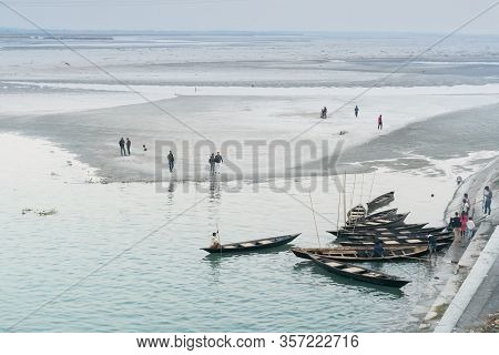 Dooars, West Bengal, India - December 3rd 2017 : View Of Gajoldoba Barrage With Boats In Foreground,