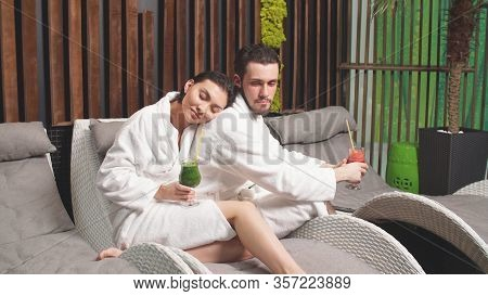 Cute Man With A Beard Is Relaxing With His Beloved Woman In A Spa Center.