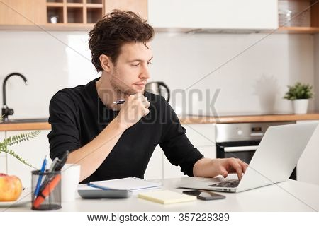 Young Man Working At Home. Home Office, Remotely Working Concept