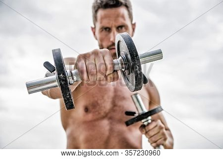 Workout Concept. Healthy Mind In A Healthy Body. Muscular Man Exercising With Dumbbell. Dumbbell Exe