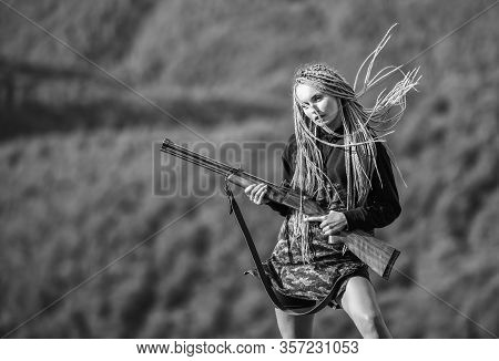 Hunting Season. Woman Attractive Long Hair Pretty Face Hold Rifle For Hunting. Dangerous Girl. Defen