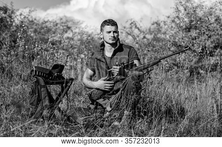 Recharge Rifle Concept. Man With Rifle Hunting Equipment Nature Background. Hunting Equipment And Sa
