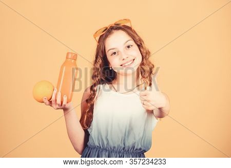 Happy Childhood. Natural Vitamin Source. Kid Girl Eat Orange Fruit And Drink Orange Juice. Vitamin N