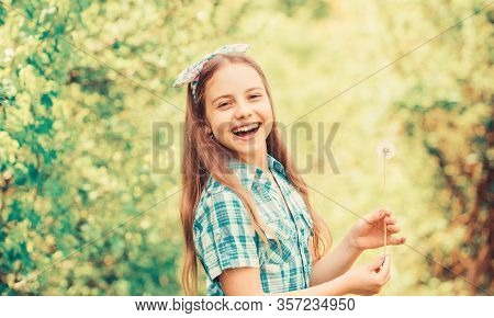 Summertime Fun. Folklore Beliefs About Dandelion. Girl Rustic Style Making Wish And Blowing Dandelio