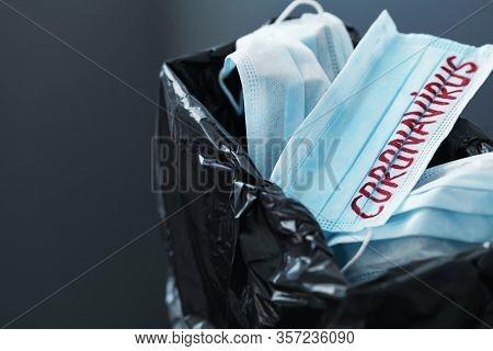 Used Medical Masks Against Coronavirus In Trash Bin. Corona Virus Or Covid-19 Concept.
