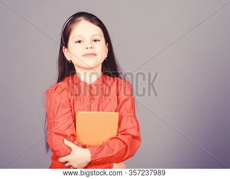 Language And Literature Textbook For Self Study. Cute Little Child Holding Book In English Literatur