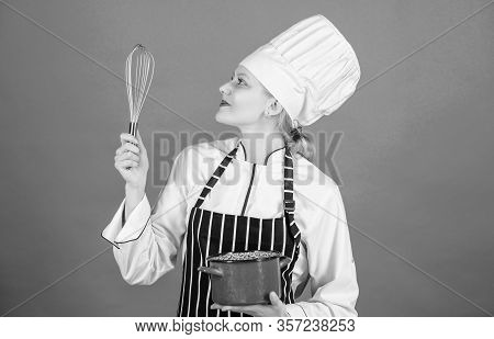 Girl In Apron Whipping Eggs Or Cream. Start Slowly Whisking Whipping Or Beating Cream. Whipping Crea