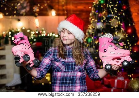 Dreams Come True. Got Gift Exactly She Wanted. Kid Near Christmas Tree Hold Roller Skates. Girl Sati