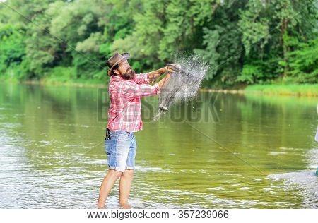 Trout Farm. Fisherman Alone Stand In River Water. Man Bearded Fisherman. Fisherman Fishing Equipment