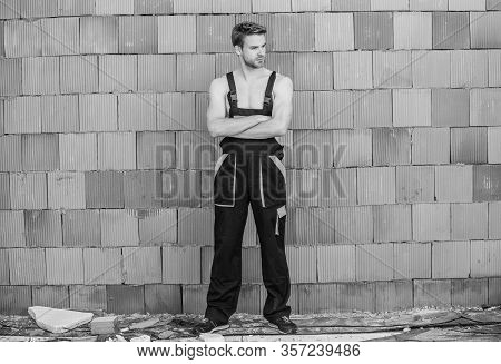 Sexy Mechanic. Worker Brick Wall Background. Building Skills And Construction. Man Build House. Skil