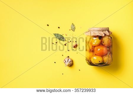 Pickled Tomatoes In Jar On Yellow Background. Top View. Flat Lay. Copy Space. Canned And Preserved V