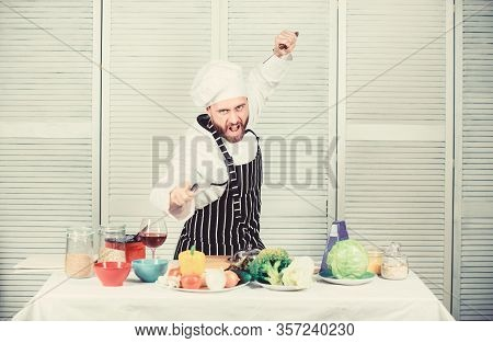 Chef Hold Cleaver Knife Tool Ready To Chop Ingredients. Man Wear Apron Cooking In Kitchen. Man Use S
