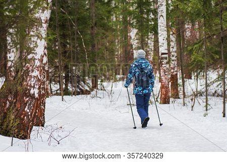 A Woman On A Winter Walk