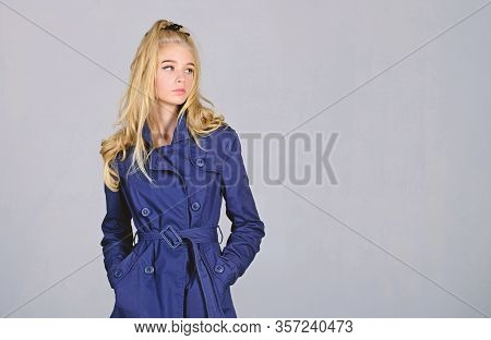 Trench Coat Fashion Trend. Must Have Concept. Fashionable Coat. Woman Makeup Face Blonde Hair Posing