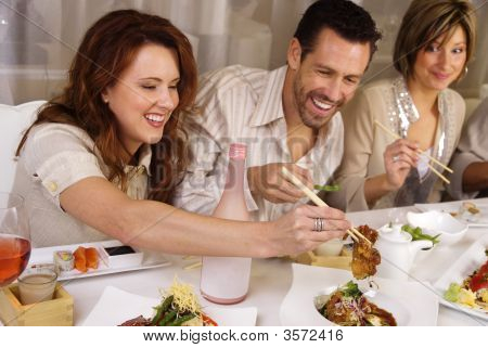 People Eating And Socializing At A Restaurant