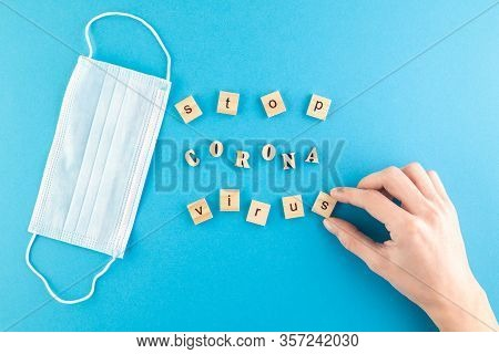 The Inscription Stop Coronavirus Laid Out Of Wooden Cubes On A Blue Background. Medical Concept For