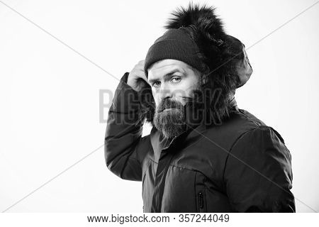 Winter Season Menswear. Weather Resistant Jacket Concept. Man Bearded Stand Warm Jacket Parka Isolat