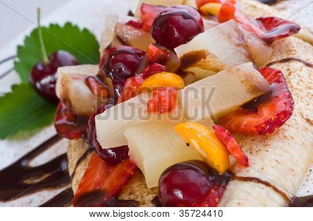 Stock Photo: Fruit salad with ice-cream and banana.