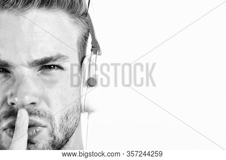 Relax Playlist. Sexy Muscular Man Listen Music From Playlist. Man Relax In Earphones Isolated On Whi